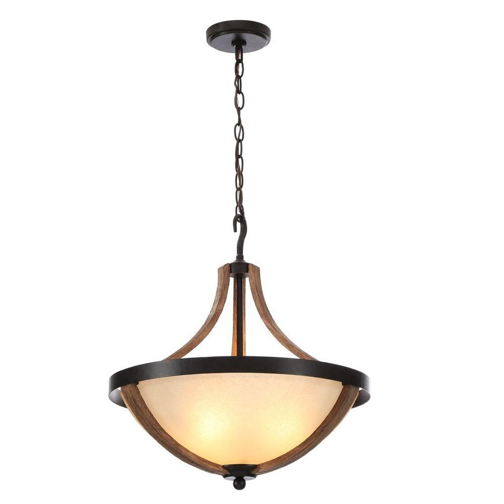 This pendant light features an irised scavo glass bowl