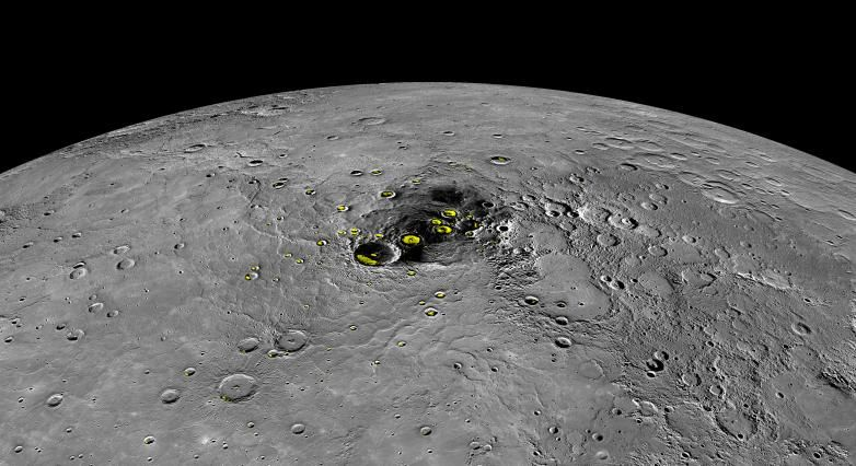 This orthographic projection view from NASA's MESSENGER spacecraft provides a look at Mercury's north polar region. The yellow regions in many of the craters mark locations that show evidence for water ice, as detected by Earth-based radar observations.