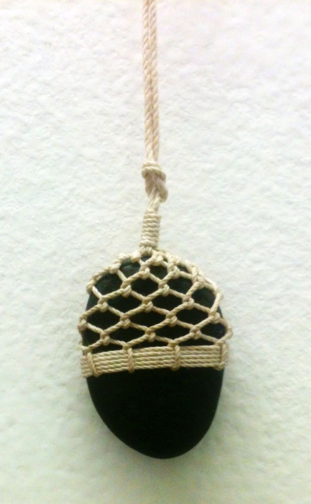 Beach stone necklace by Tim Whitten of Stonington Maine using traditional knotwork with Irish linen.