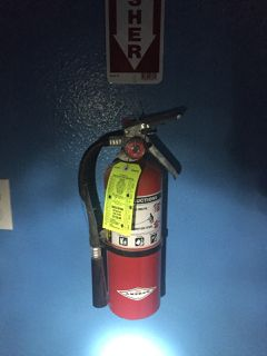 FIRE EXTINGUISHERS 3 ON WALL. ONE NOT