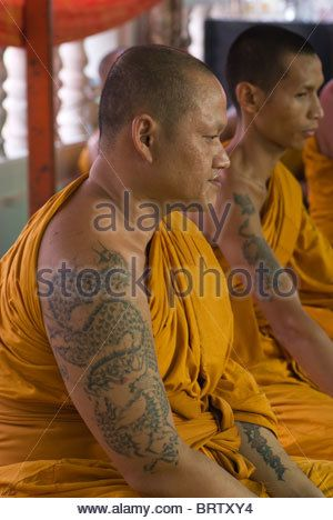 Monk with Tattoo - Stock Image