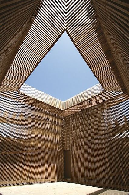 Thin wooden layers define the space and contain light as for Space definition in architecture