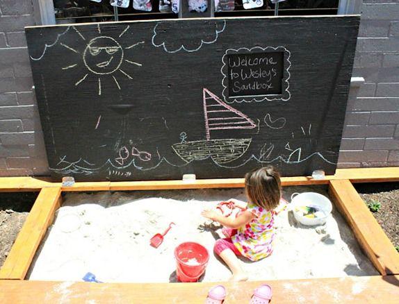sandbox built into deck with chalkboard top