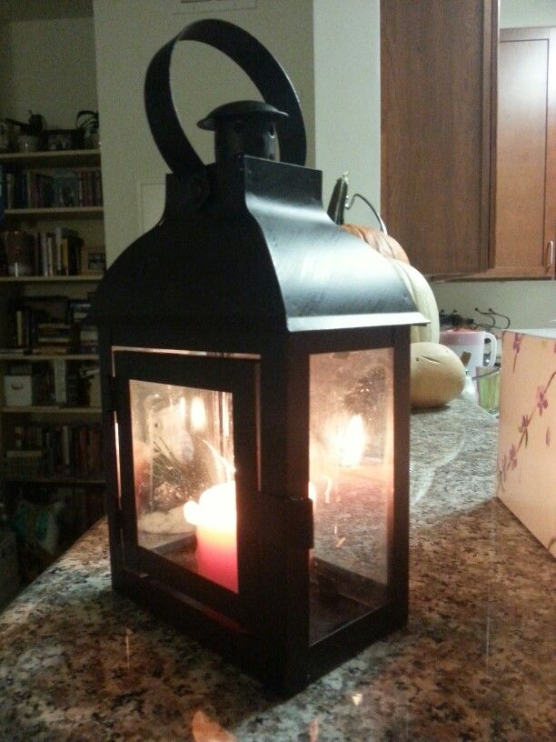 Going to decorate this lantern for Christmas. I'm thinking about putting it on the shelf where I hang the stockings. Country or old fashioned rustic Christmas theme.