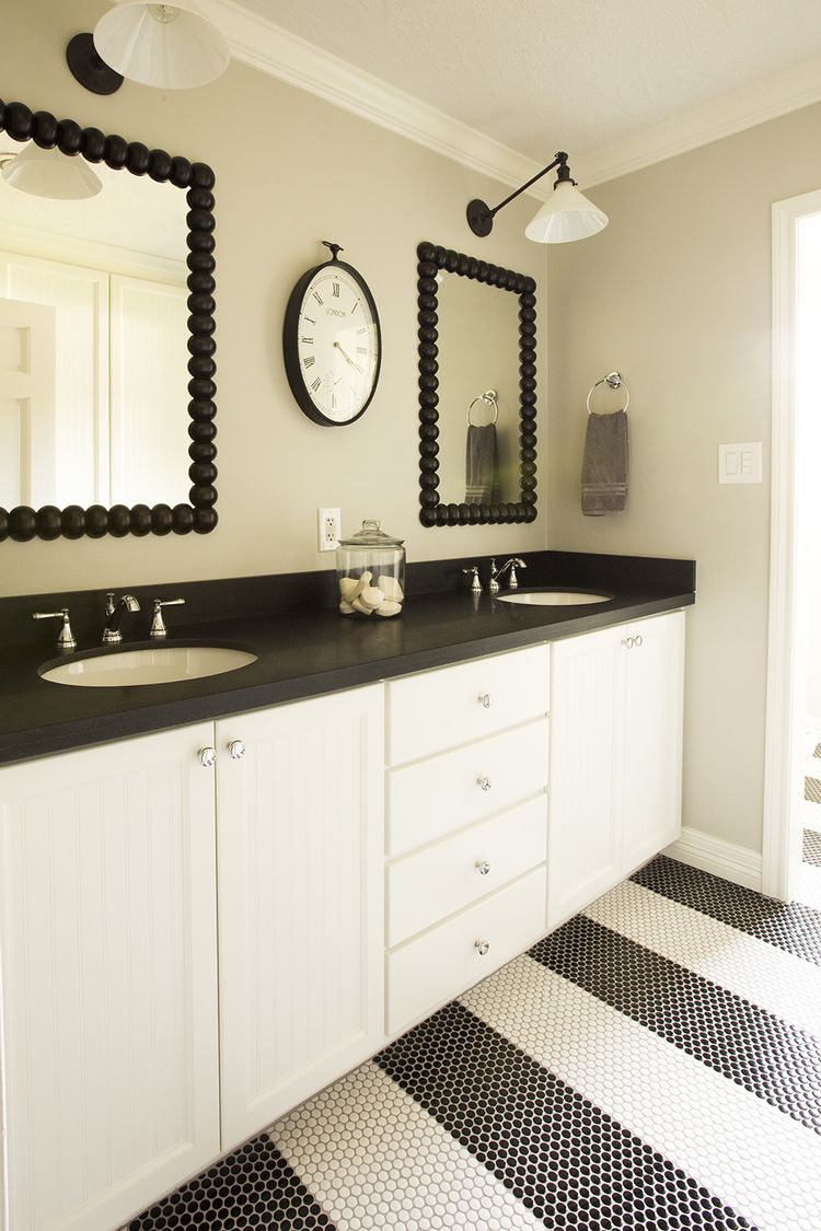 Young boys bathroom with striped penny dot tiles and honed - Black marble bathroom countertops ...
