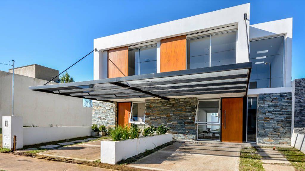 Casas Adosadas Casas Modernas Ideas Imágenes Y Decoración De Estudio A 3 Moderno Homify Fachada De Piedra Casa Adosada Galerias De Casas