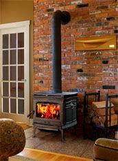 Black Wood Stove Exposed Brick Wall We Re Making It Happen Wood Stove Wood Stove