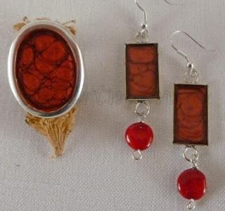 Set of earrings and ring