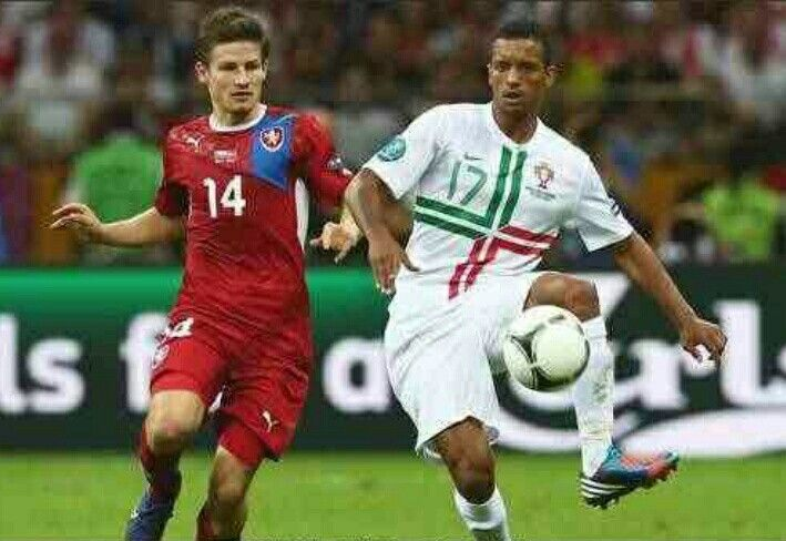 Portugal 1 Czech Rep 0 in 2012 in Warsaw. Nani passes the ball with Vaclav Pilar moving in to challenge in the Quarter Final of Euro 2012.