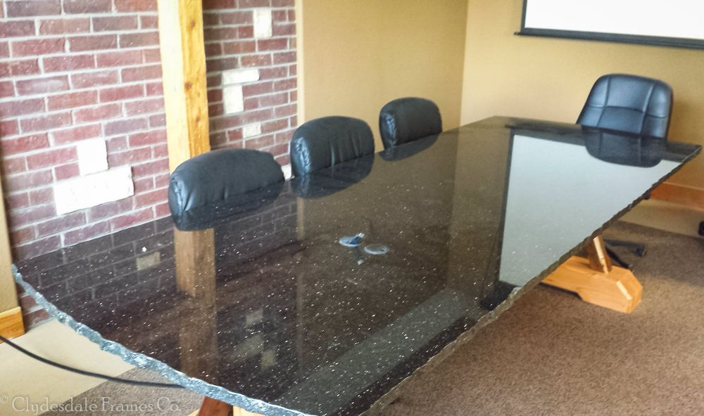 A Granite Conference Table Top Supported By A Timber Frame - Granite conference table
