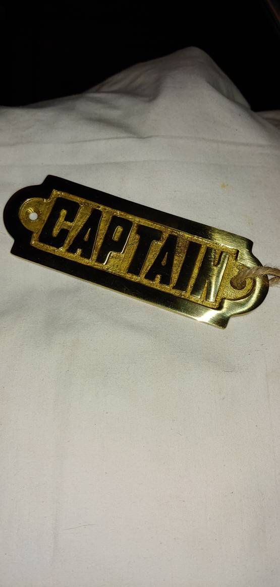 brass plate that says captain wall decor boat decor brass on hole in the wall cap oriental id=85069
