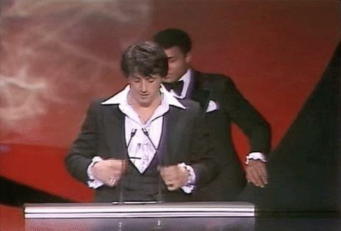 Ali sneaking up on Stallone during his Oscar speech.