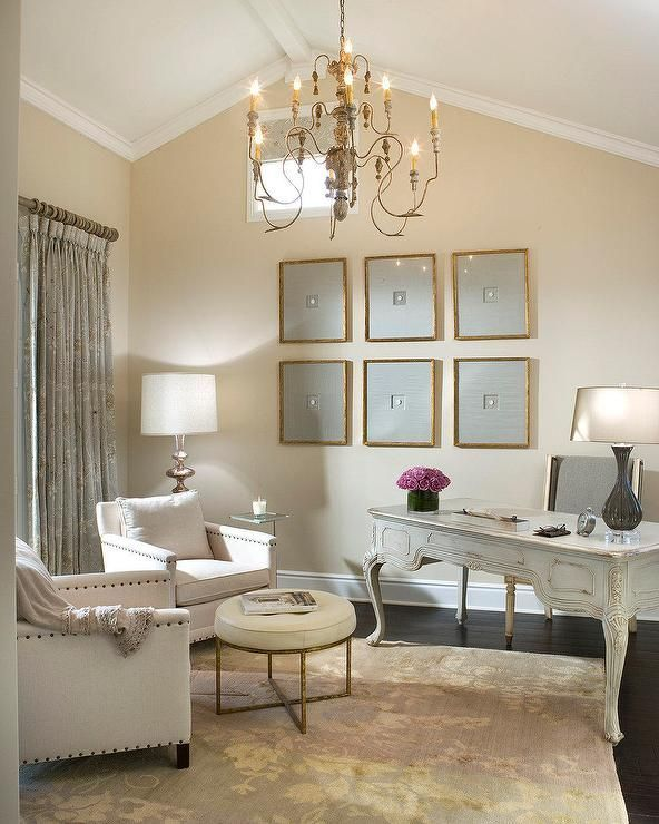 Vallone Design Elegant Office With Vaulted Ceilings Dark Hardwood Floors And Latte Colored Walls Sitting Is The New Smoking Desks