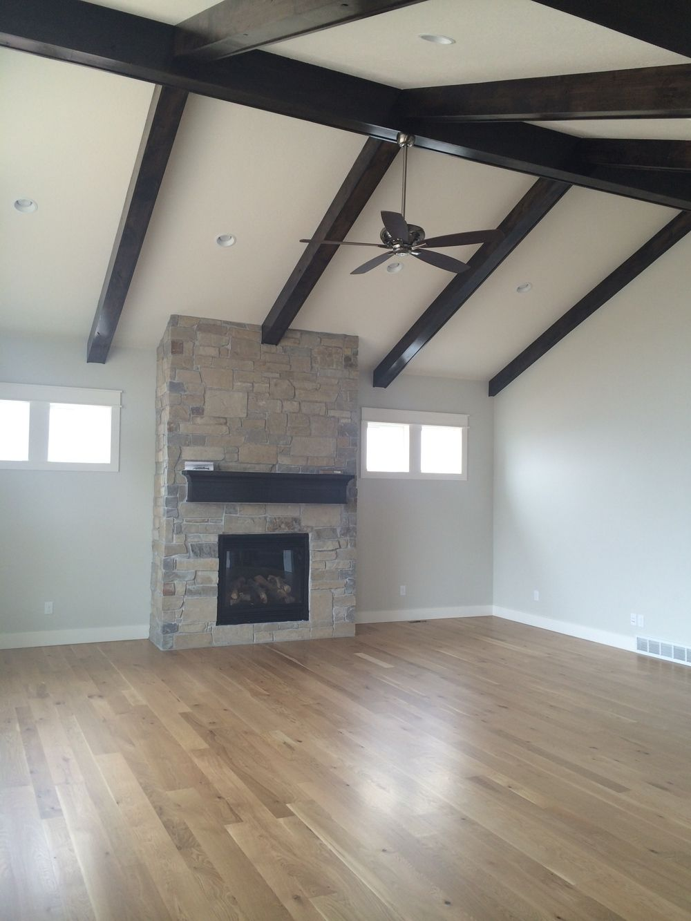 Faux beams highlight the vaulted ceiling. The beams and