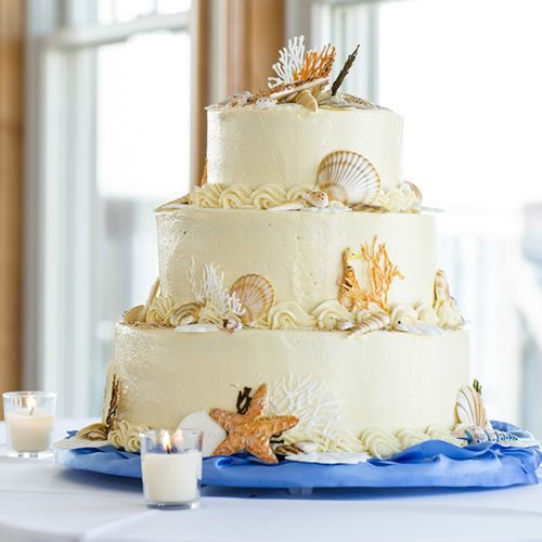 Real Weddings - In Bliss Weddings: Heather & Luke. Heather and Luke were blown away by this amazing beach-themed wedding cake which was a surprise from their caterer, LBI Small Potatoes, LLC. This incredible cake showed astonishing detail with its edible sea shells and starfish decorations! Image Credit: Uncorked Studios