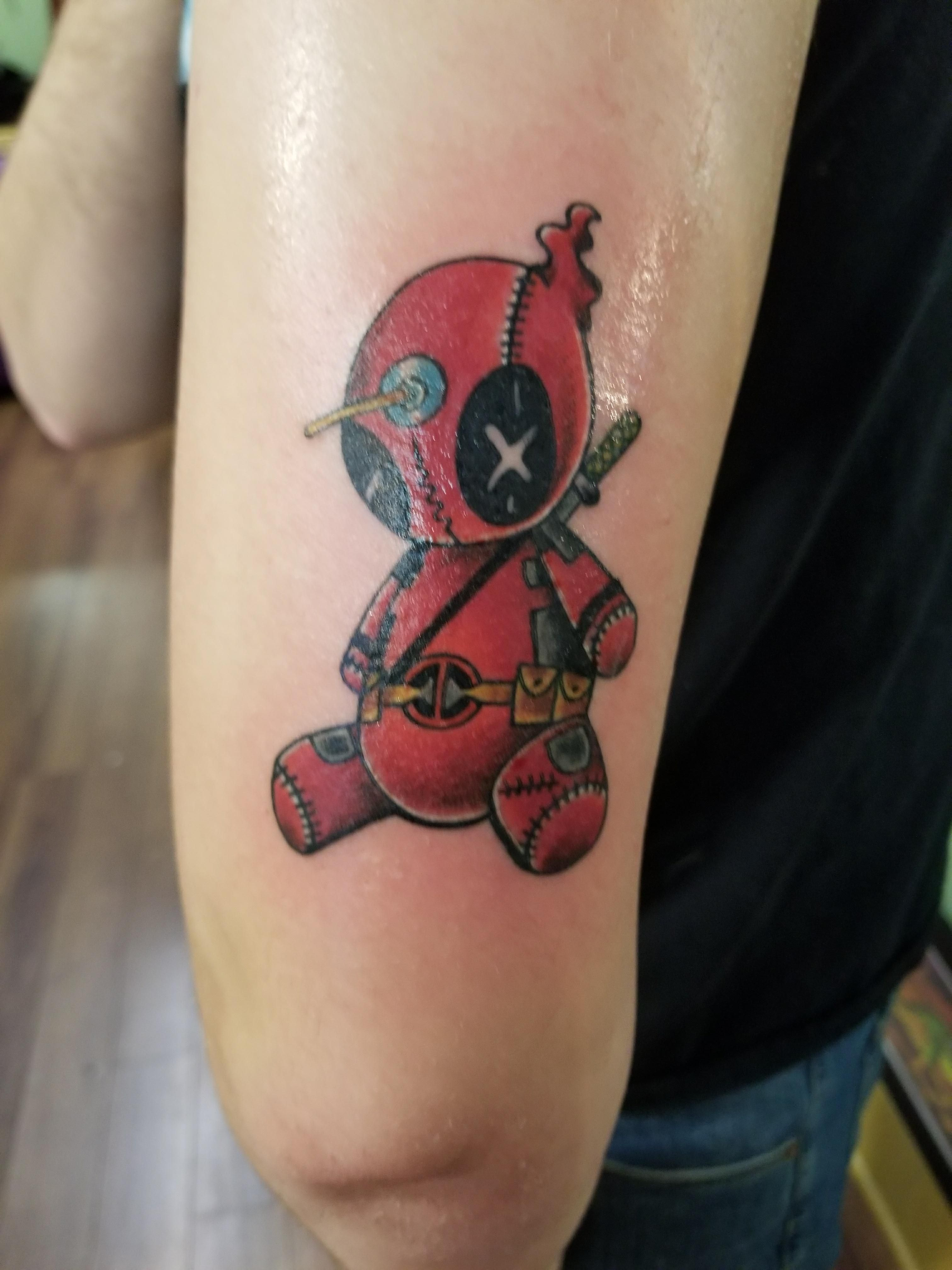 Deadpool voodoo doll tattoo. Work done by Jeff at Red Handed Tattoo ...