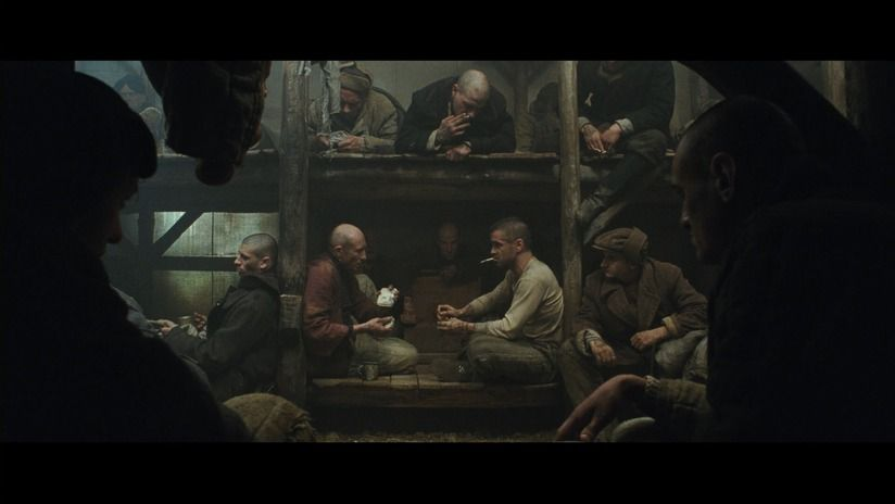 "A painting-like depiction of a Russian Gulag in ""The Way Back"" (2010) - with great composition of fore- and mid-ground, atmospheric haze and top-lighting, all suggesting a dense, stuffy barrack in which these men have to last for days at a stretch."