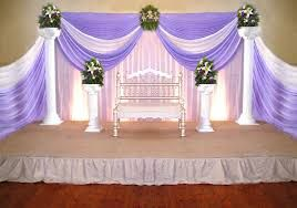 Simple Wedding Stage Decor With Pink And Purple Drapes Also Valuable Tips That You Must Note