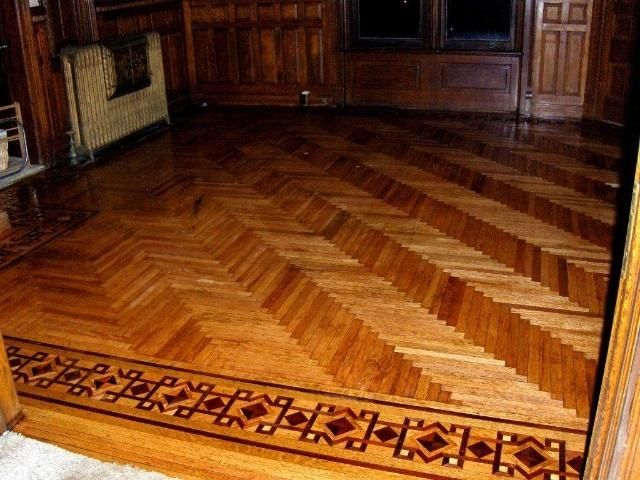 Parquet flooring herringbone with intricate border inlay for Inlaid wood floor designs