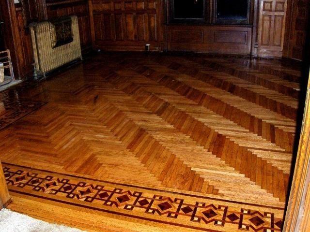 Parquet flooring herringbone with intricate border inlay for Inlaid wood floor designs