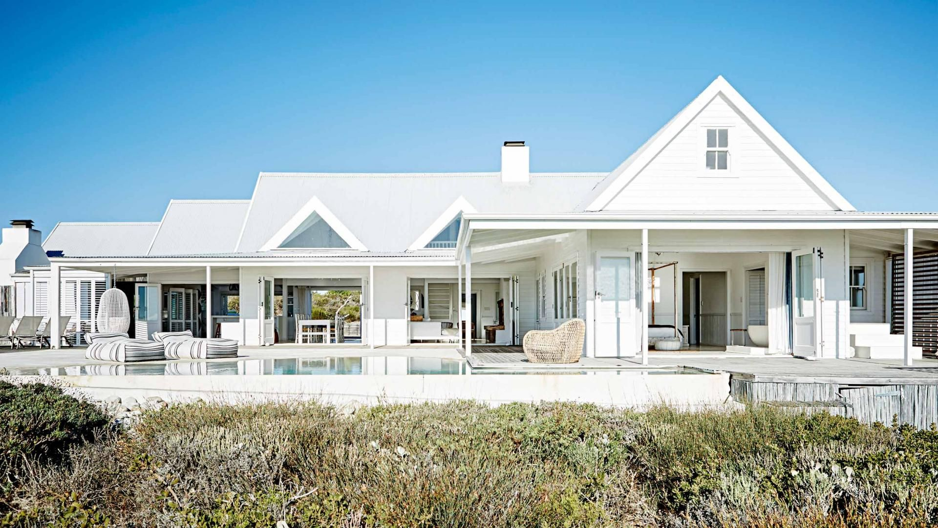 Gravity home white seaside home in south africa outdoor for Coastal style house plans