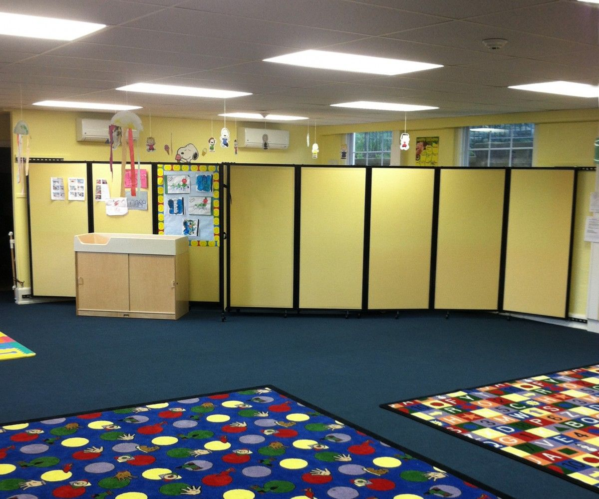 Wall-mounted mobile classroom dividers are utilised to separate ...