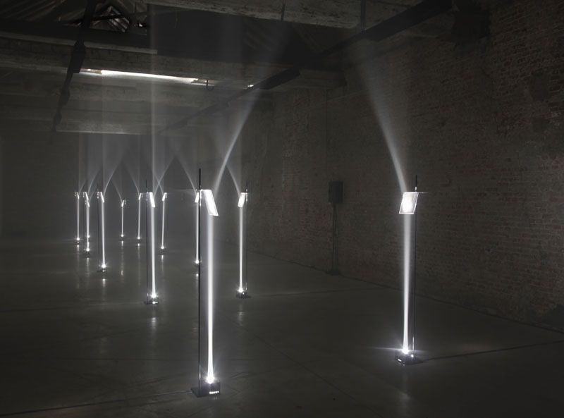 ARCADES (2012)    'Arcades' is a site specific installation that inscribes one architectural space within another; an arcade made of the light is implanted into a space defined by strong brick walls, a pitched roof and exposed wooden beams, that of a former stable.