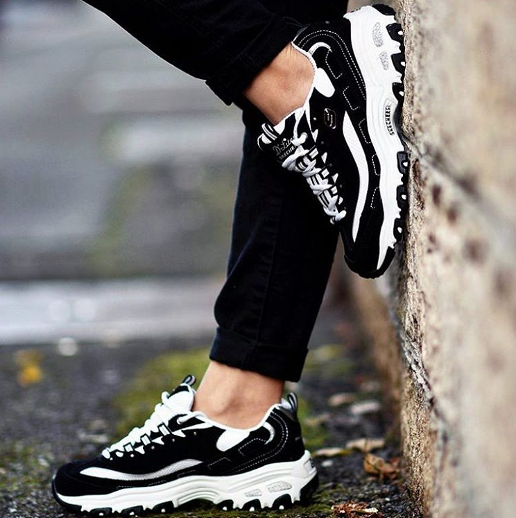 A classic look gets updated with comfort in the SKECHERS D Lites - Biggest  Fan shoe. 0a3eed35d