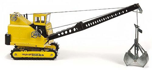 Toy power shovel with a functional crane-mounted clamshell