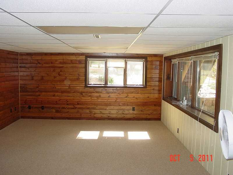 Wood Paneling And Windows In This Basement Done After Water Damage By Rsm Home Improvements Chic Home Decor Chic Interior Design Chic Home Design