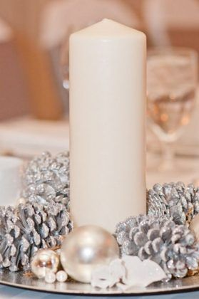 winter candle and pinecone wedding centerpiece