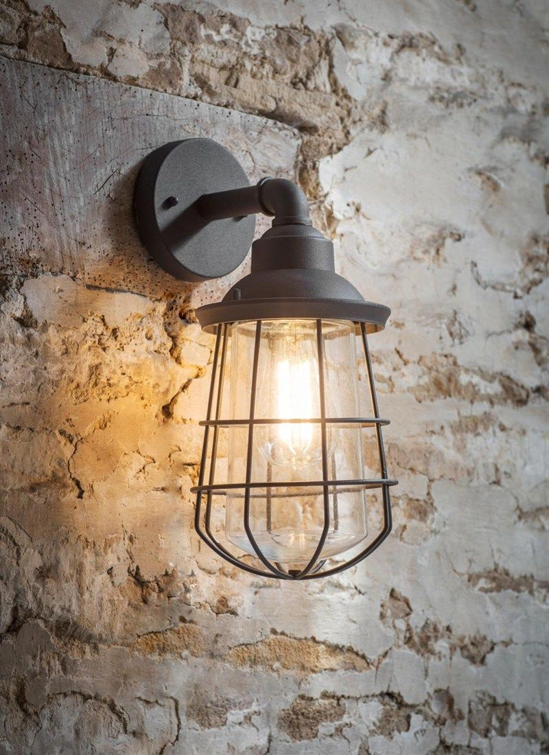 The striking caged design of the Finsbury Wall Light adds an ...