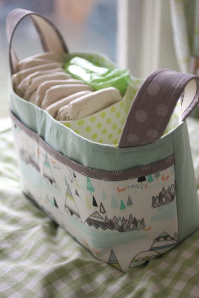 2b0d89ebf0 Divided Diaper Storage Basket: Keep one in the living room so you don't  have to trek up and down the stairs every time you need to change baby's  diaper.