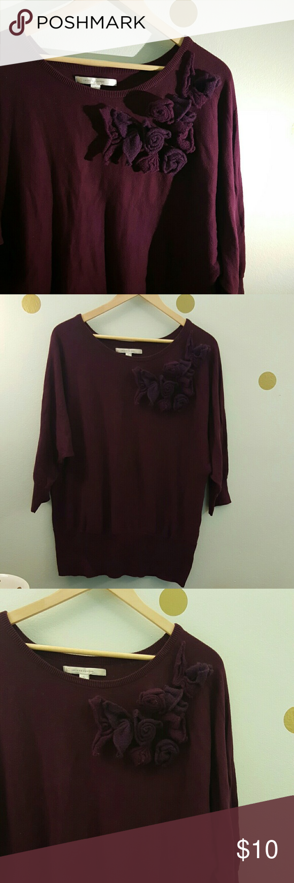 LC by Lauren Conrad purple oversized sweater It is a plum purple  color. Sleeves are oversized. And it has such a pretty flowery detail by the shoulder. LC Lauren Conrad Sweaters Crew & Scoop Necks