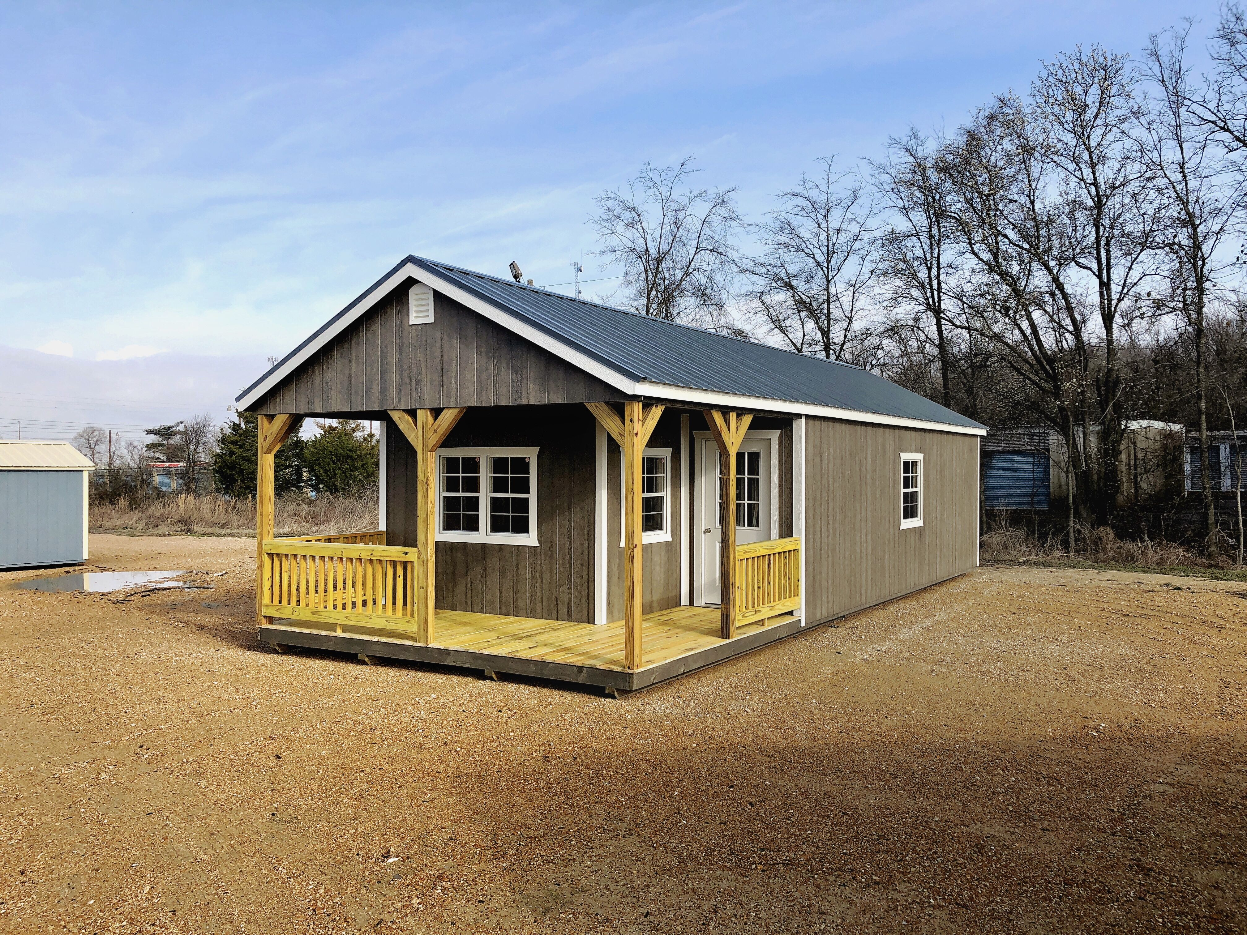 Deluxe cabin built with an I-shaped porch and has three 2X3