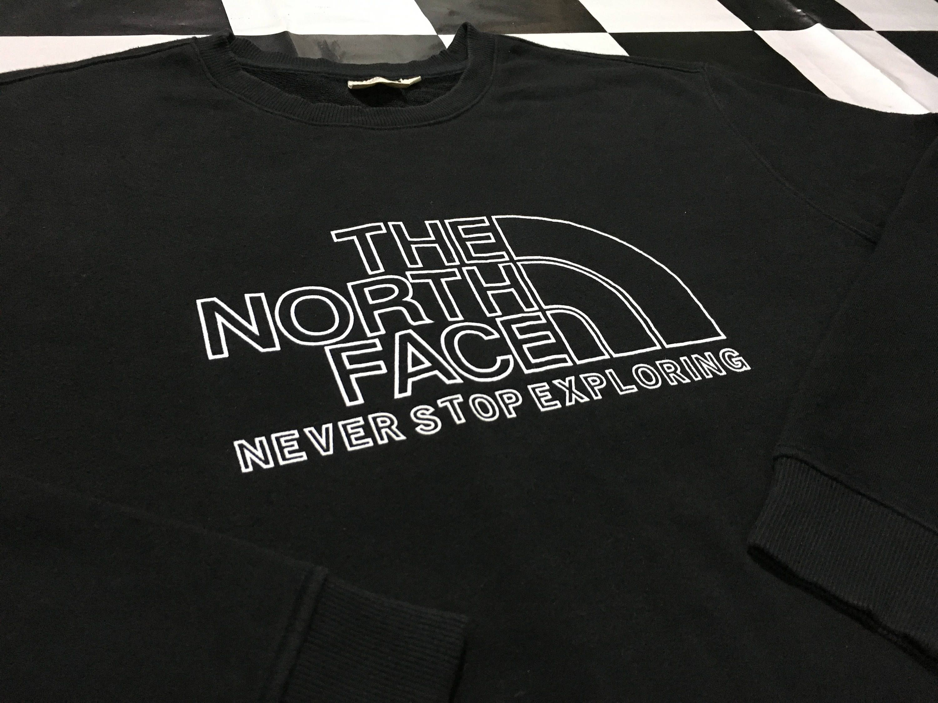 34b930550 Vintage The north face sweater big logo spell out Never stop ...