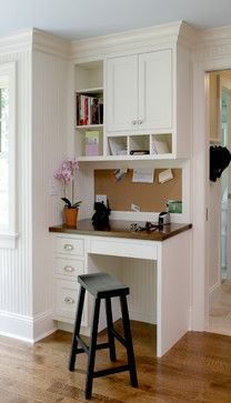 Side View Of Cabinets With Bulletin Board Between Uppers And