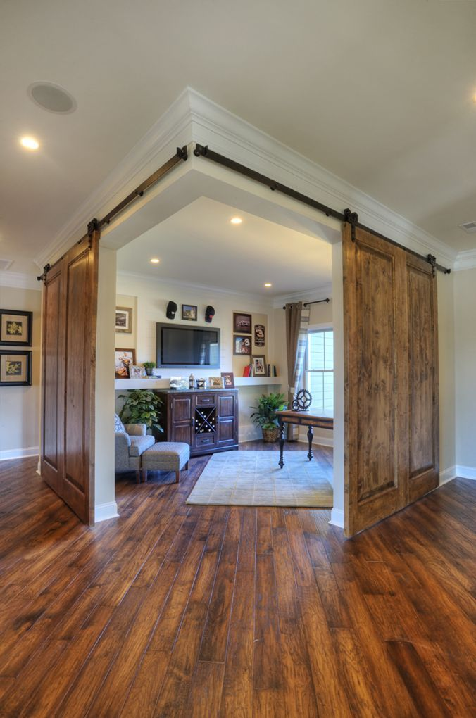 Corner office or study area with double sliding barn doors Pole barn house plans with basement