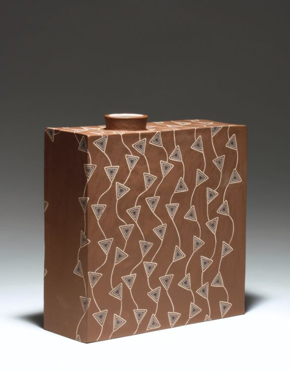 Sumiko Takada's flower vase, 9.5 in. (24 cm) in length, brown stoneware, galze, fired to cone 5, 2016. This can be found in the March 2017 issue of Ceramics Monthly.
