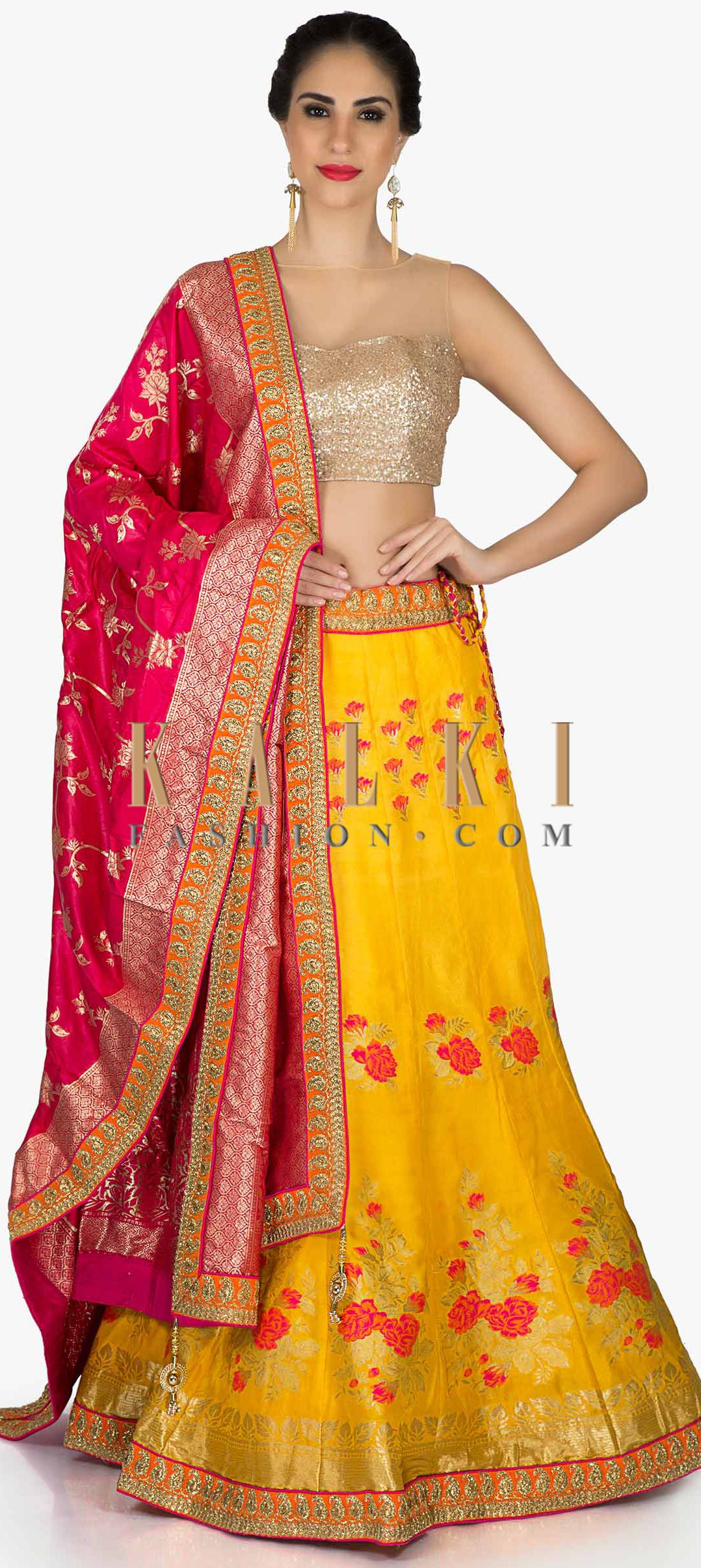 5a09de46280334 Amber yellow lehenga in floral motif with contrast rani pink dupatta in  brocade only on Kalki