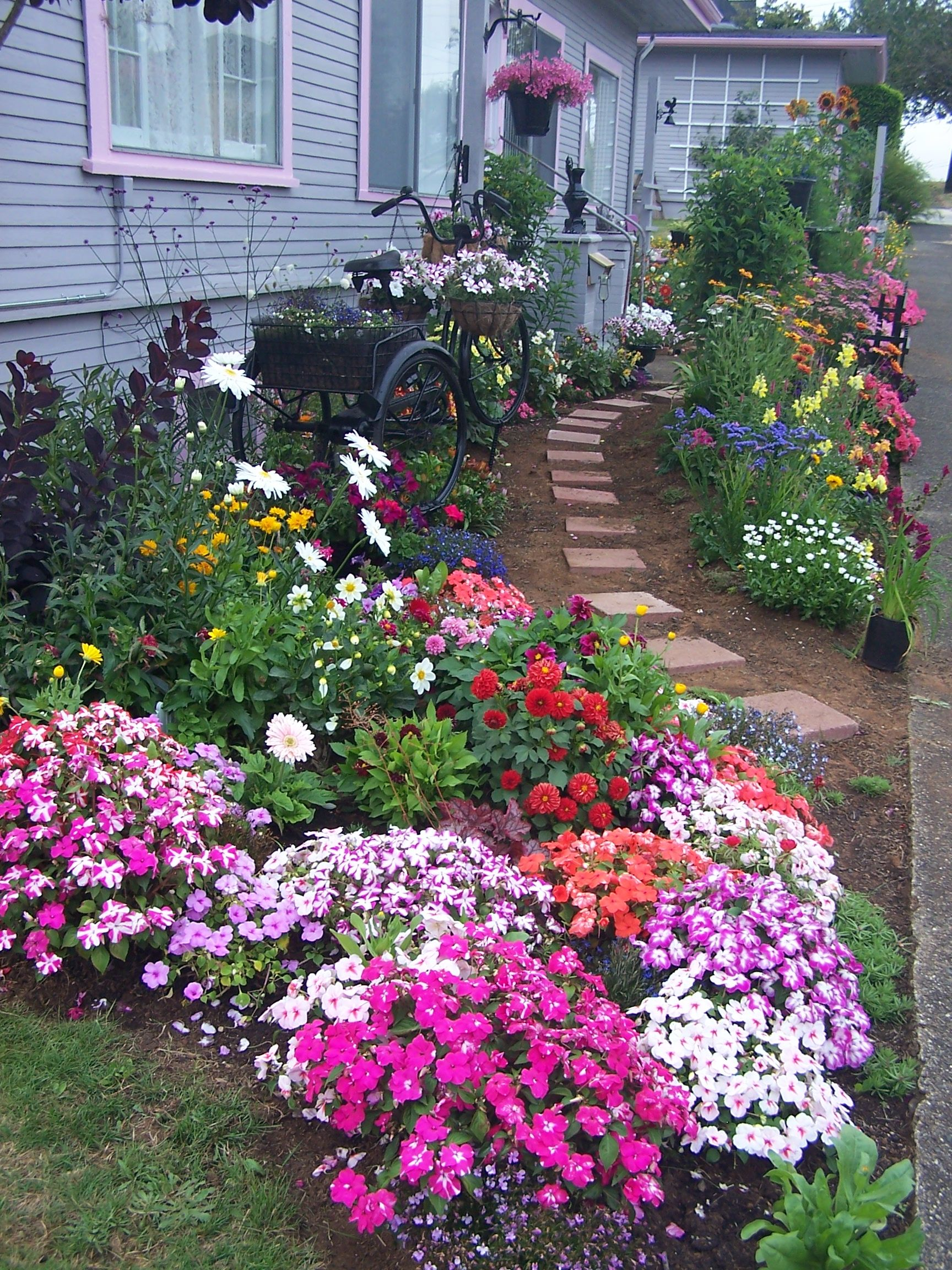 cottage garden with path and tricycle planter beautiful on beautiful front yard rock n flowers garden landscaping ideas how to create it id=22532