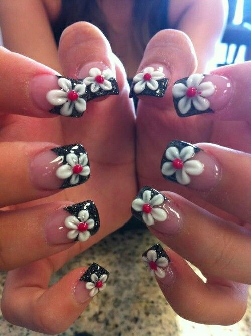 Gorgeous white flower black tips gel nail design