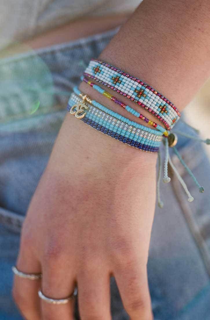 Bracelets friendship on wrist new photo