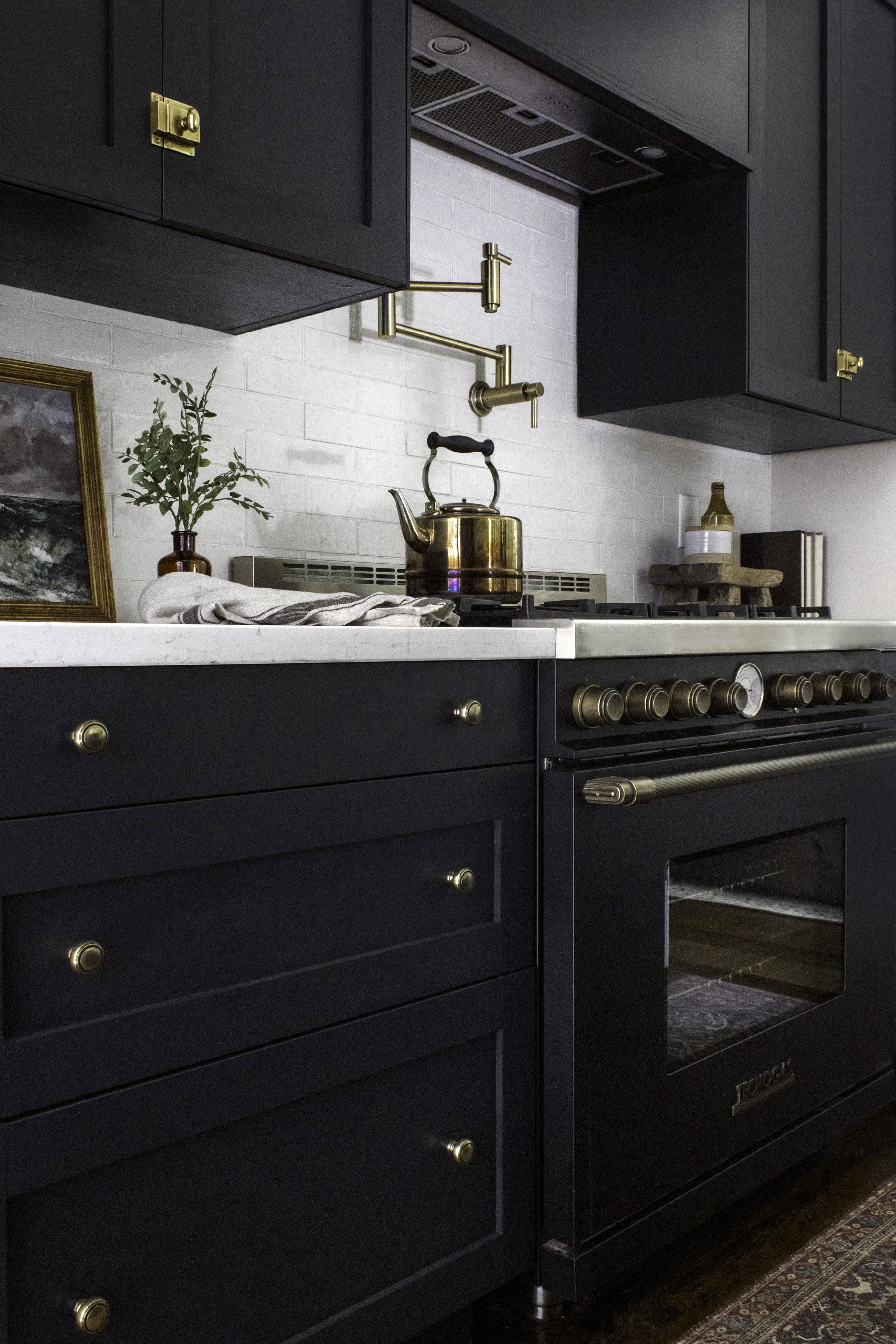 Brass Accents And Ebony Doors Make For A Darkly Dramatic Kitchen Victorian Kitchen Kitchen Cabinets Kitchen Design