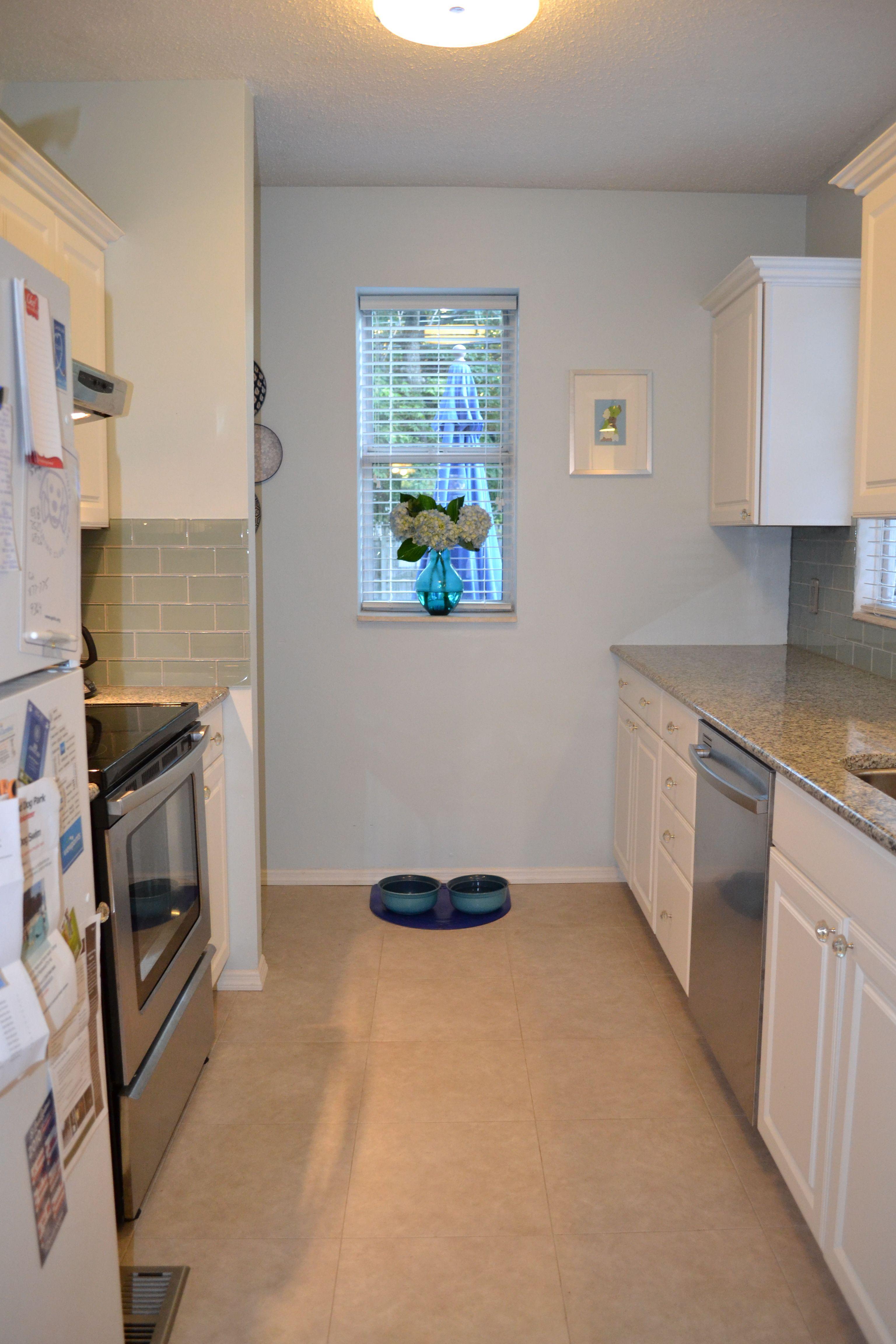 Blue Floor Tiles Kitchen Ivory Cabinets Black Countertops Gray Floor Slate Blue Wall