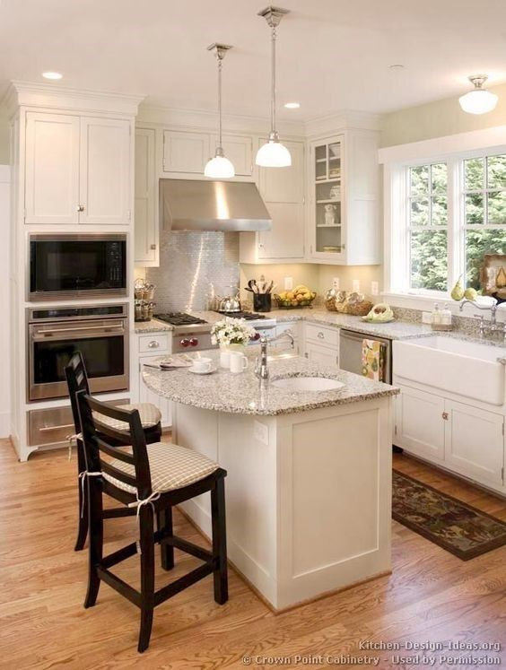 A Small L Shaped Kitchen With Double Eye Level Oven