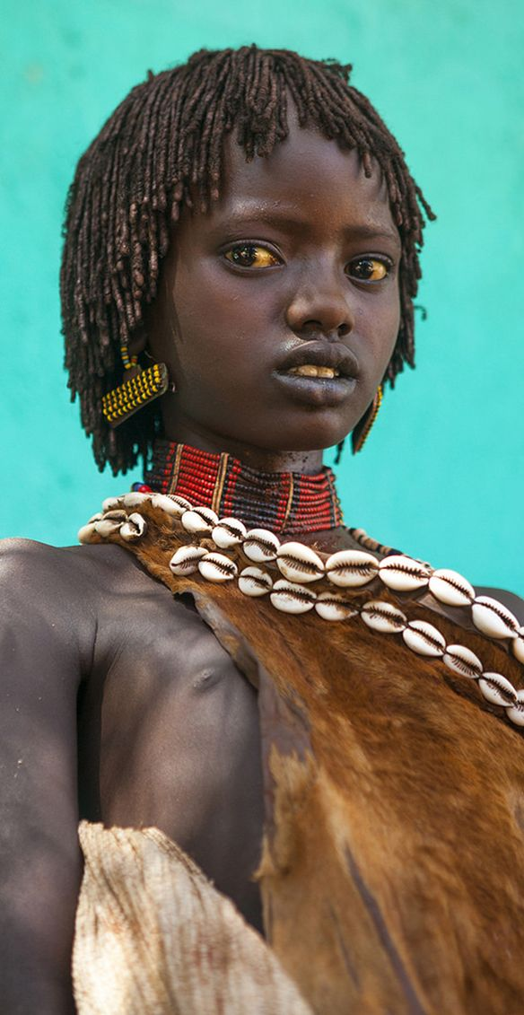 The Faces of the World (Omo Valley) by Eric Lafforgue