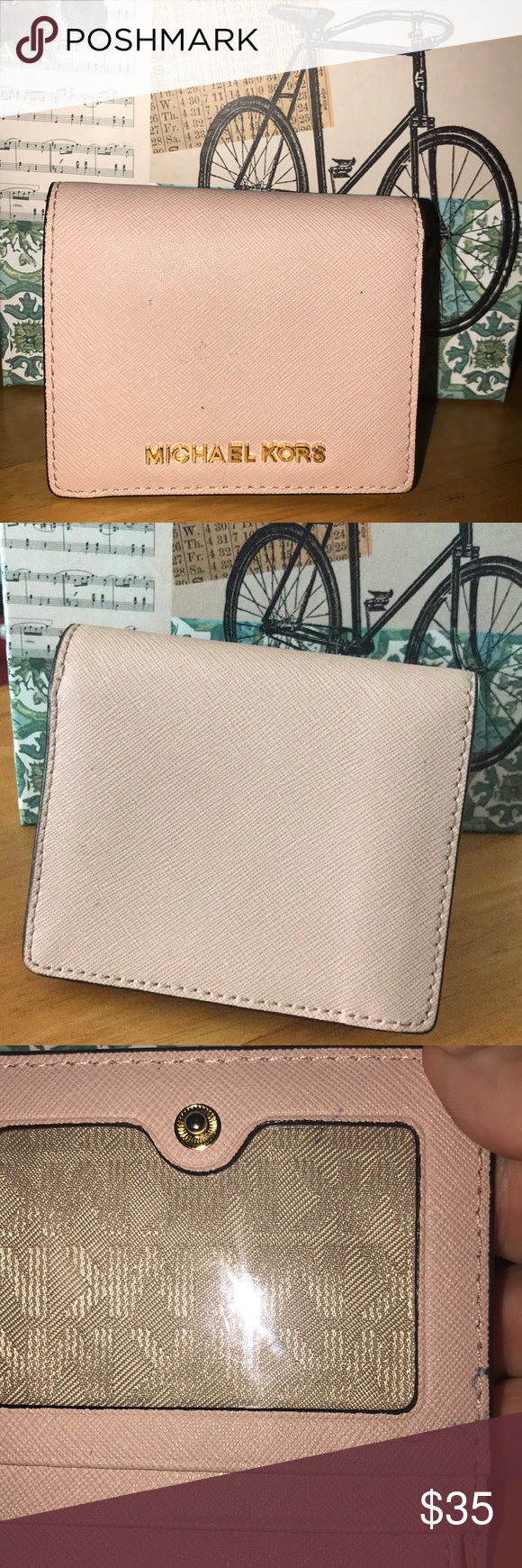 6ff6b9b21eeb MK wallet Michael Kors Mercer Cooper trifold wallet in a peachy beige tone.  Authentic and used. Picture shows small ink stain on inside.