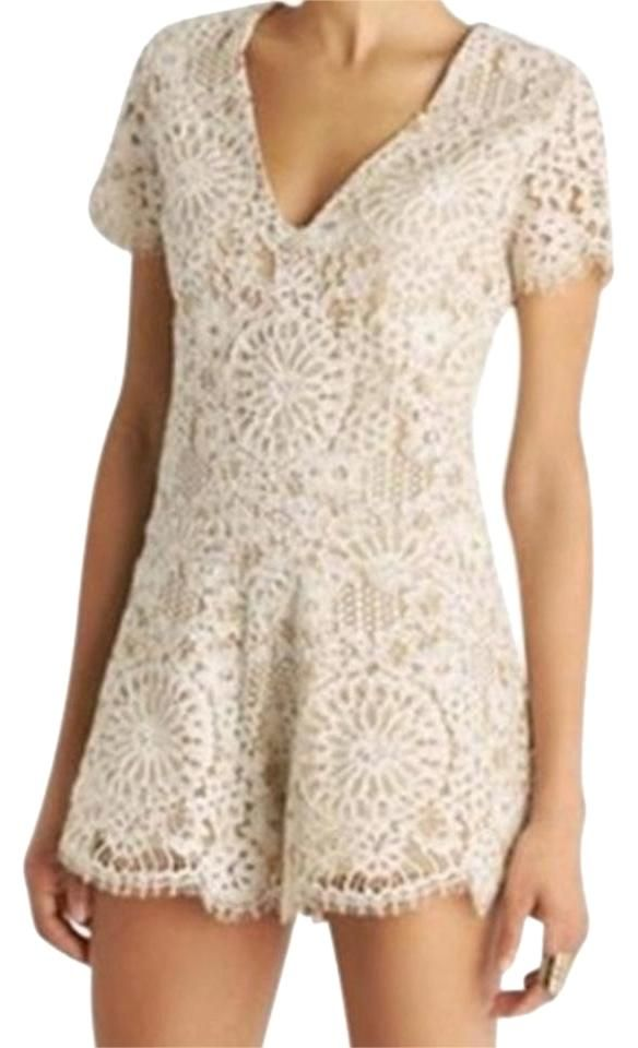 6d1daa7b6784 Free shipping and guaranteed authenticity on Alexis Ivory Lace Floral V-neck  Classic Drop Waist Small Romper JumpsuitAlexis Lace Romper Size Small.