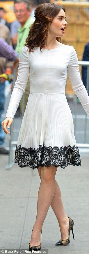 Gorgeous: The 24-year-old wore a long sleeve shift dress featuring an A-line skirt complete with black lace trim
